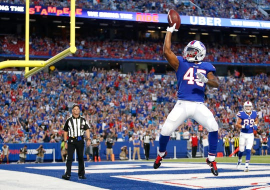 Buffalo Bills running back Marcus Murphy celebrates after scoring a touchdown run against the Carolina Panthers during the first half of an NFL football game, Thursday, Aug. 9, 2018, in Orchard Park, N.Y. (AP Photo/Jeffrey T. Barnes)