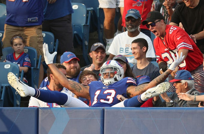 Bills receiver Kelvin Benjamin ends up in the stands after his touchdown catch from Nathan Peterman against Carolina.