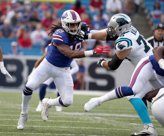 Bills rookie linebacker Tremaine Edmunds fights off a block by Carolina's Matt Kalil.