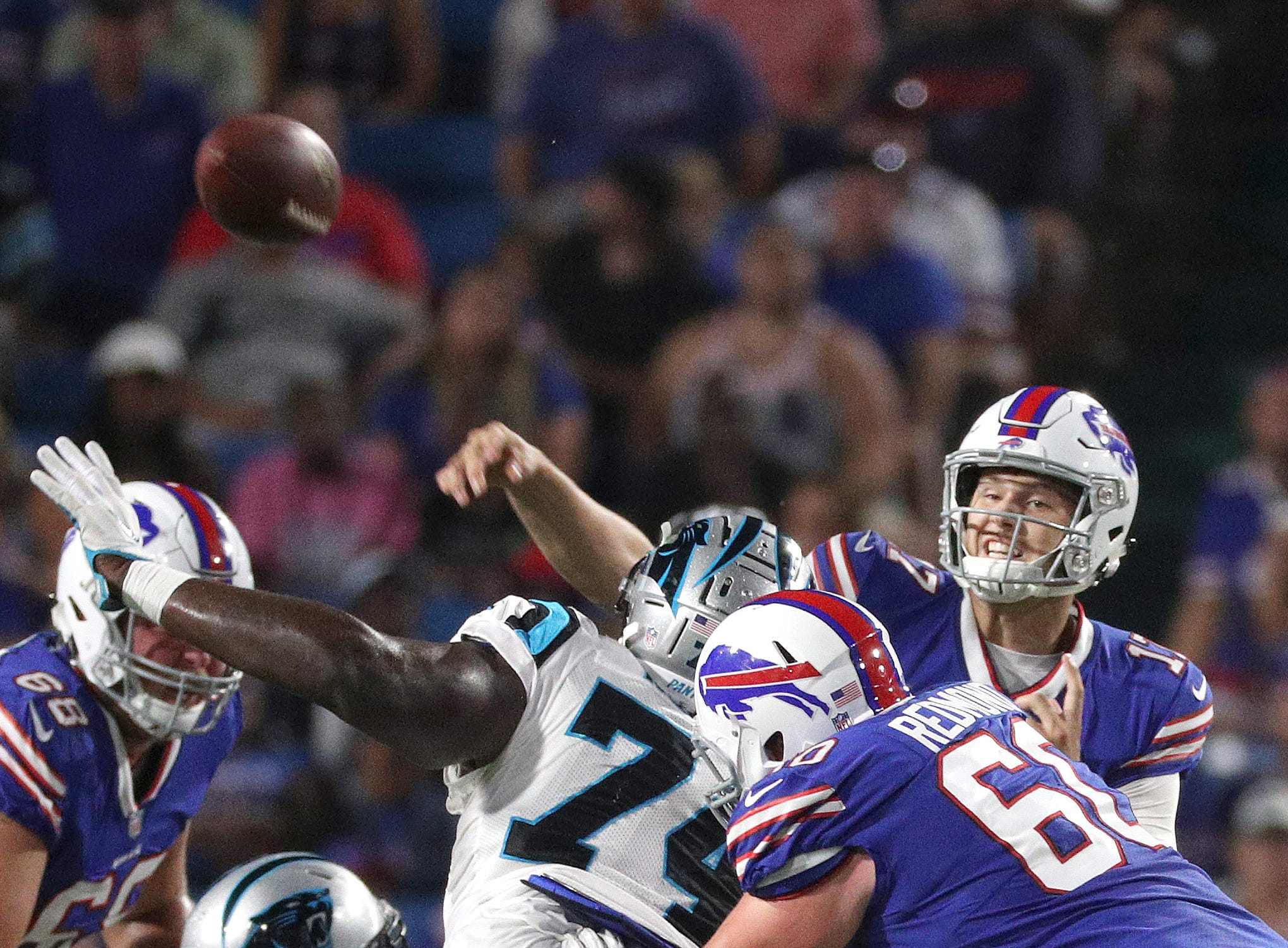 Bills quarterback Josh Allen throws under pressure against Carolina.