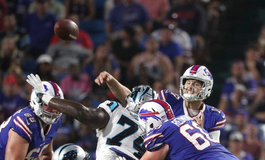 Bills quarterback Josh Allen throws under pressure against Carolina.