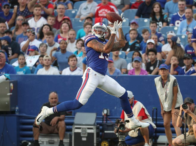 Bills receiver Kelvin Benjamin hauls in a touchdown pass from quarterback Nathan Peterman during a preseason game against Carolina.