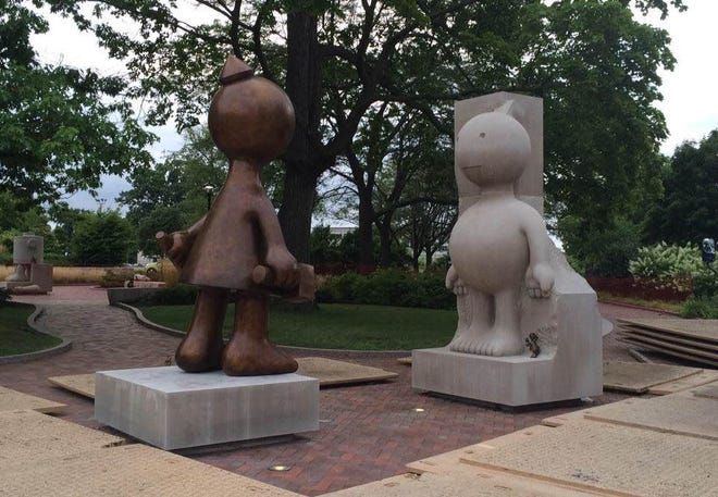 """On Thursday, a bronze version of the female figure in Tom Otterness' """"Creation Myth"""" was installed in the Memorial Art Gallery's Centennial Sculpture Park. The bronze work replaced the original limestone sculpture, which had cracked and couldn't be repaired."""