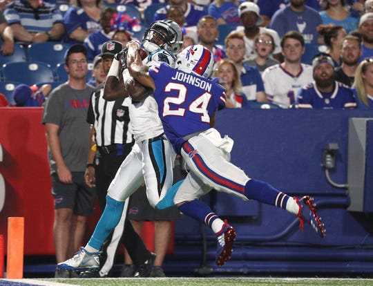 Carolina's Mose Frazier makes this catch behind Bills Taron Johnson for a touchdown.