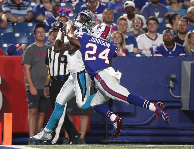 Carolina's Mose Frazier makes this catch behind Bills Taron Johnson for a touchdown.