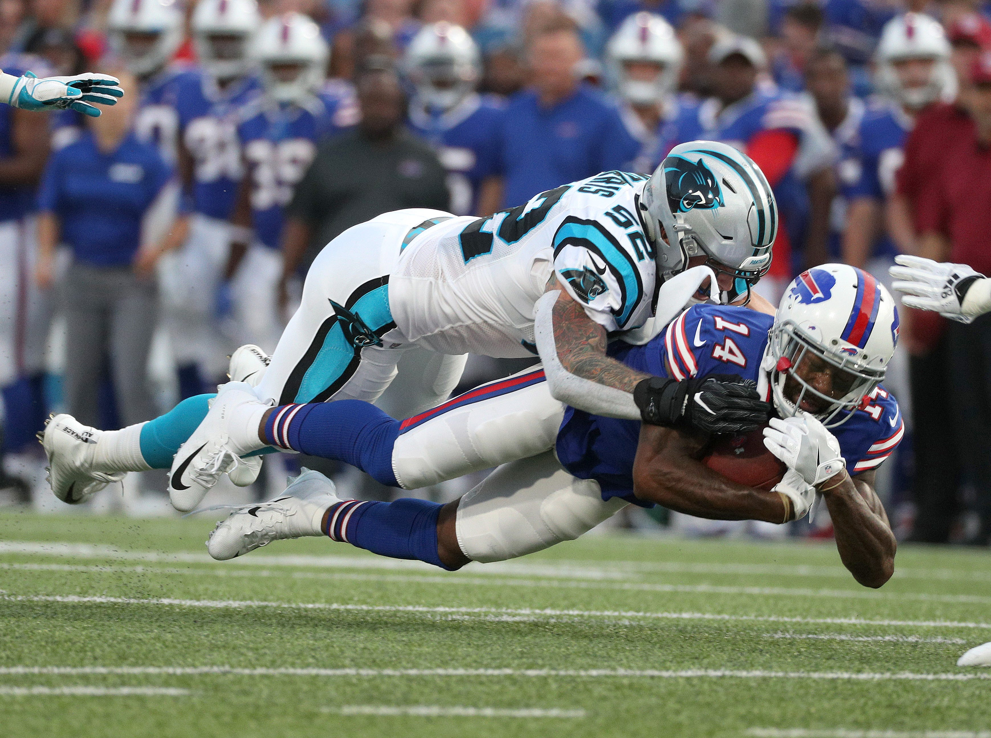 Bills receiver Jeremy Kerley is tackled by Carolina's Jared Norris after a catch.