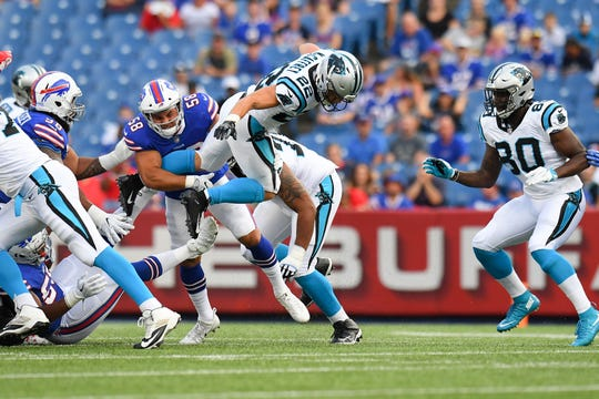 Aug 9, 2018; Orchard Park, NY, USA; Carolina Panthers running back Christian McCaffrey (22) leaps while running with the ball as Buffalo Bills linebacker Matt Milano (58) makes a tackle during the first quarter at New Era Field. Mandatory Credit: Rich Barnes-USA TODAY Sports