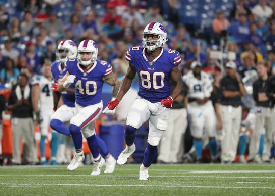Bills Jason Croom (80) and Tanner Vallejo (40) head down field on a kickoff against Carolina.