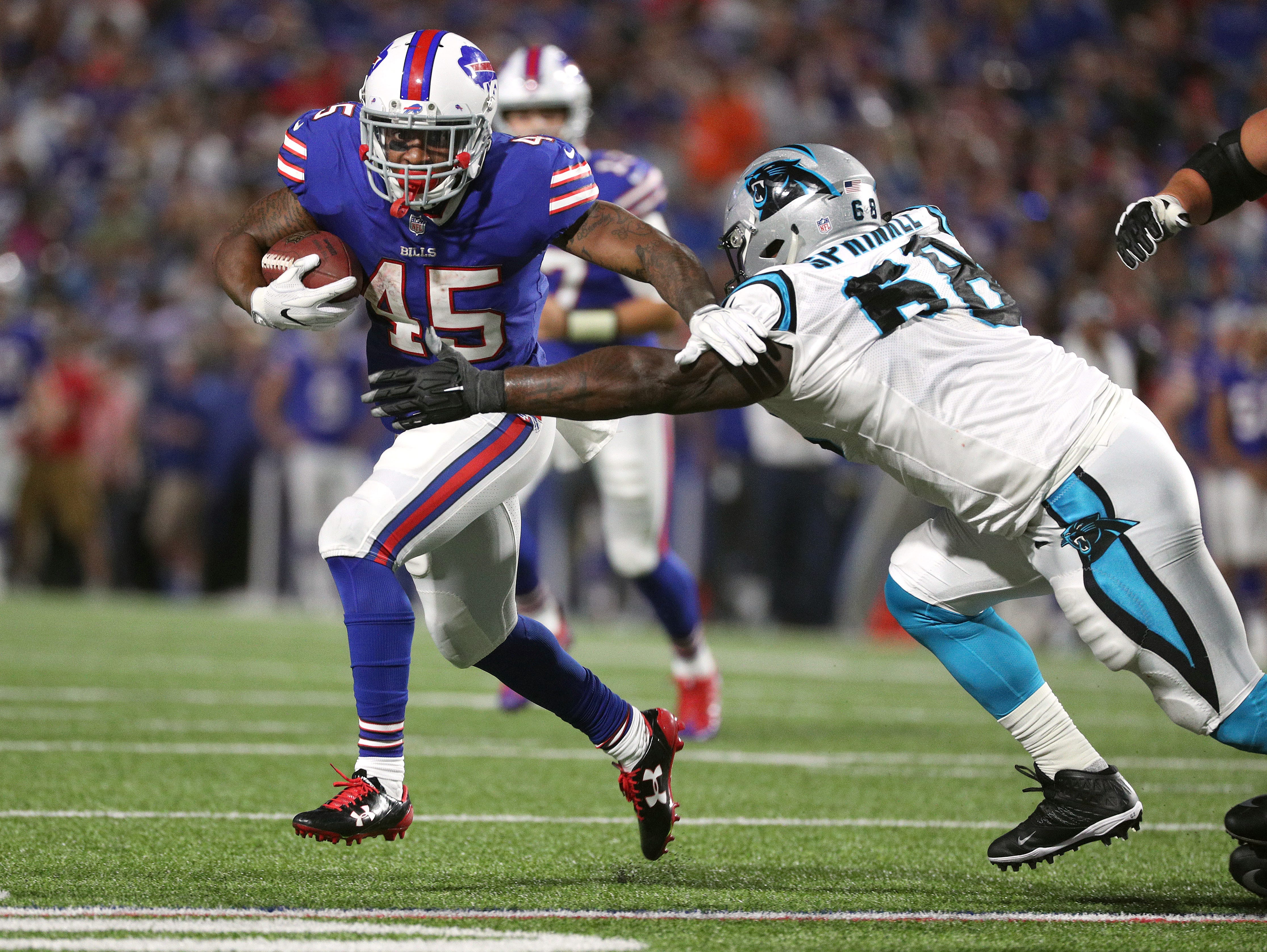 Bills running back Marcus Murphy slips a tackle by Carolina's Tracy Sprinkle.