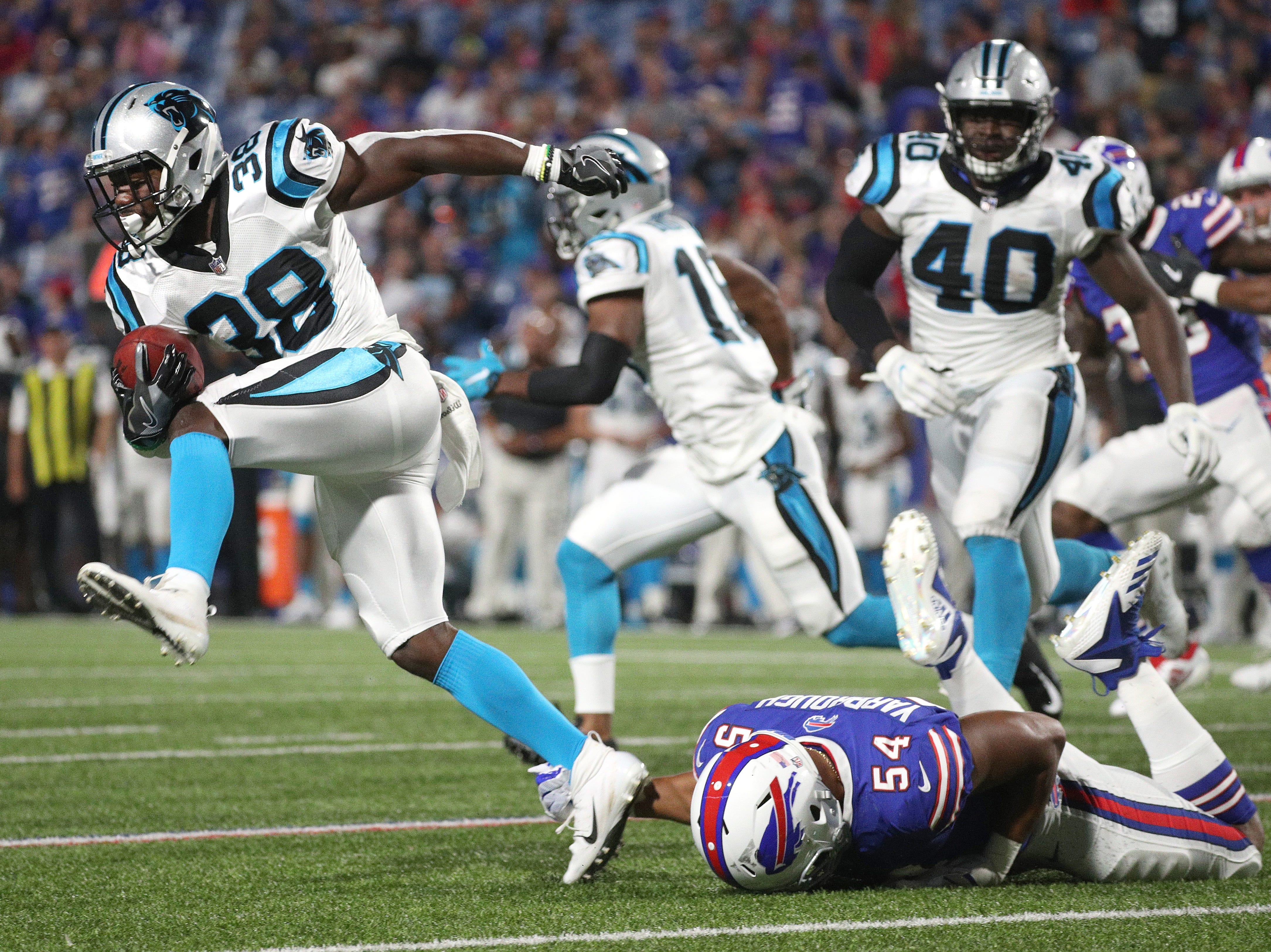 Carolina running back Kenjon Barner tries to get past Bills Eddie Yarbrough (54).