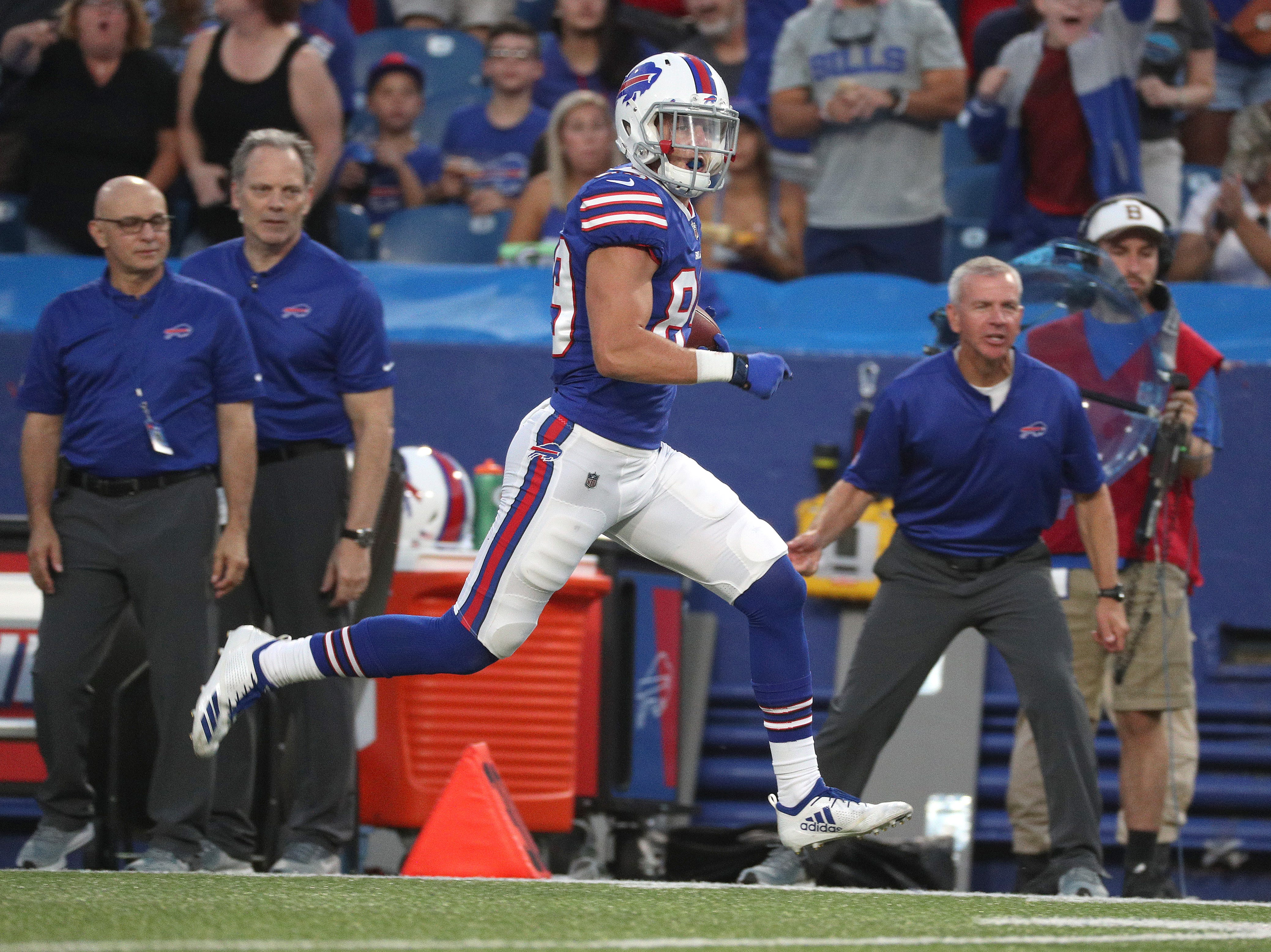 Bills receiver Brandon Reilly catches a 59-yard pass against Carolina.