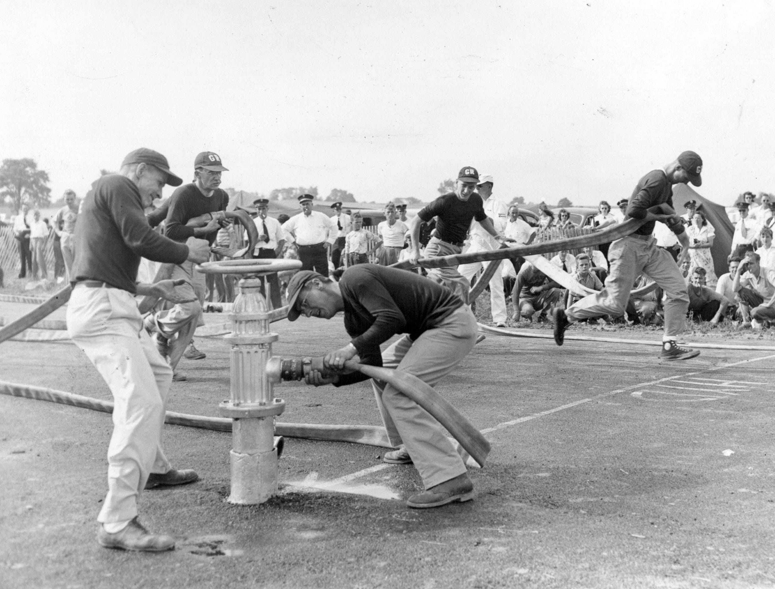 This 1948 photo shows teams from Braddock Heights and Greece-Ridge competing in the hose coupling contest at the Monroe County Fair.