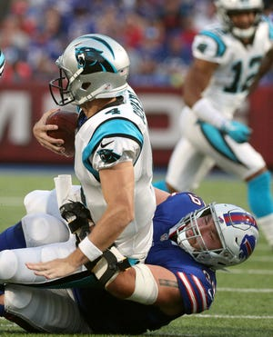 Bills Harrison Phillips sacks Carolina quarterback Garrett Gilbert.