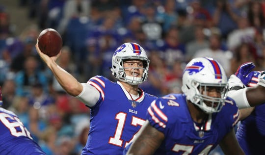 Bills quarterback Josh Allen stands in the pocket and delivers a pass.
