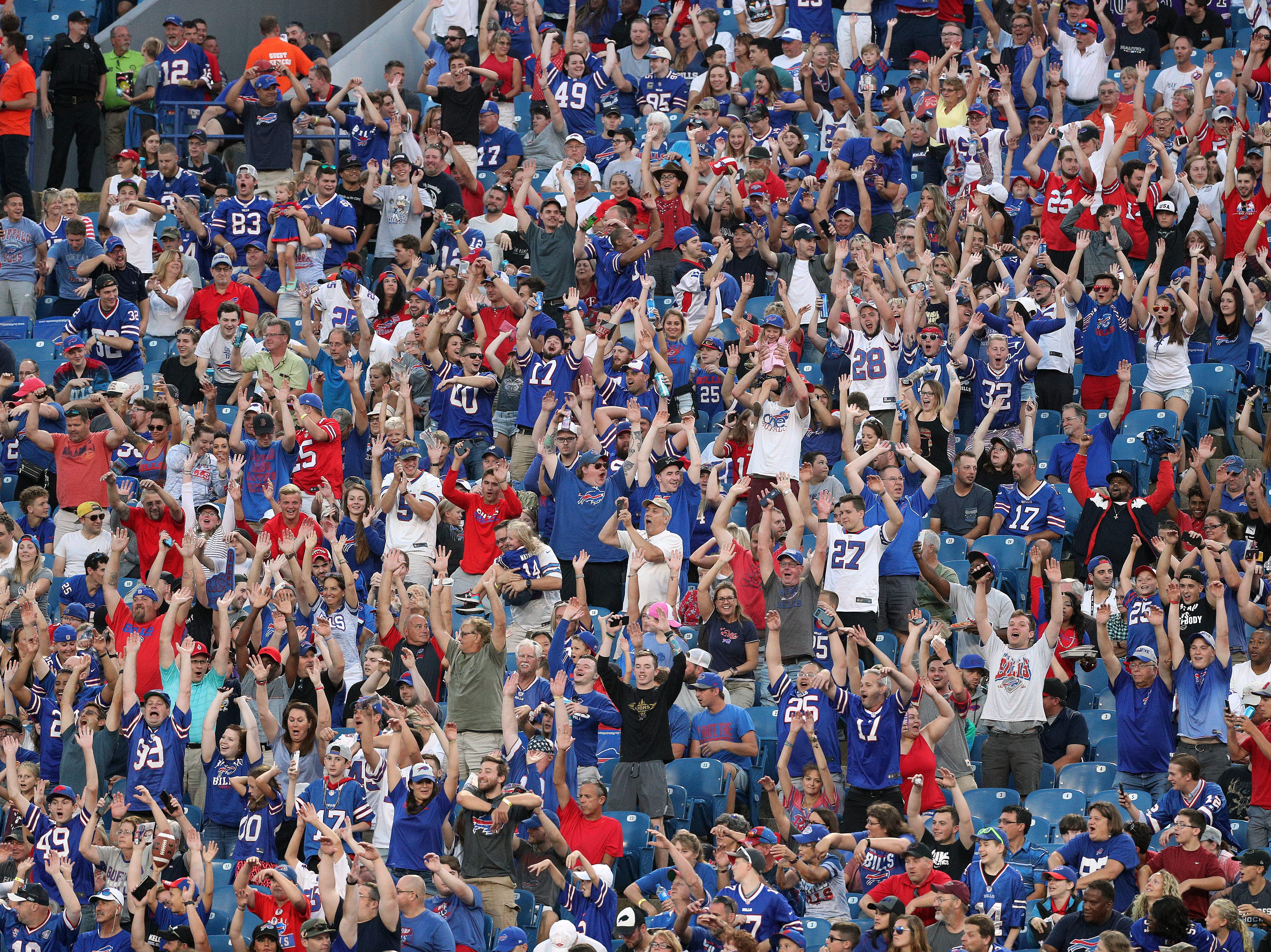 Fans join in to do the wave around New Era Field.