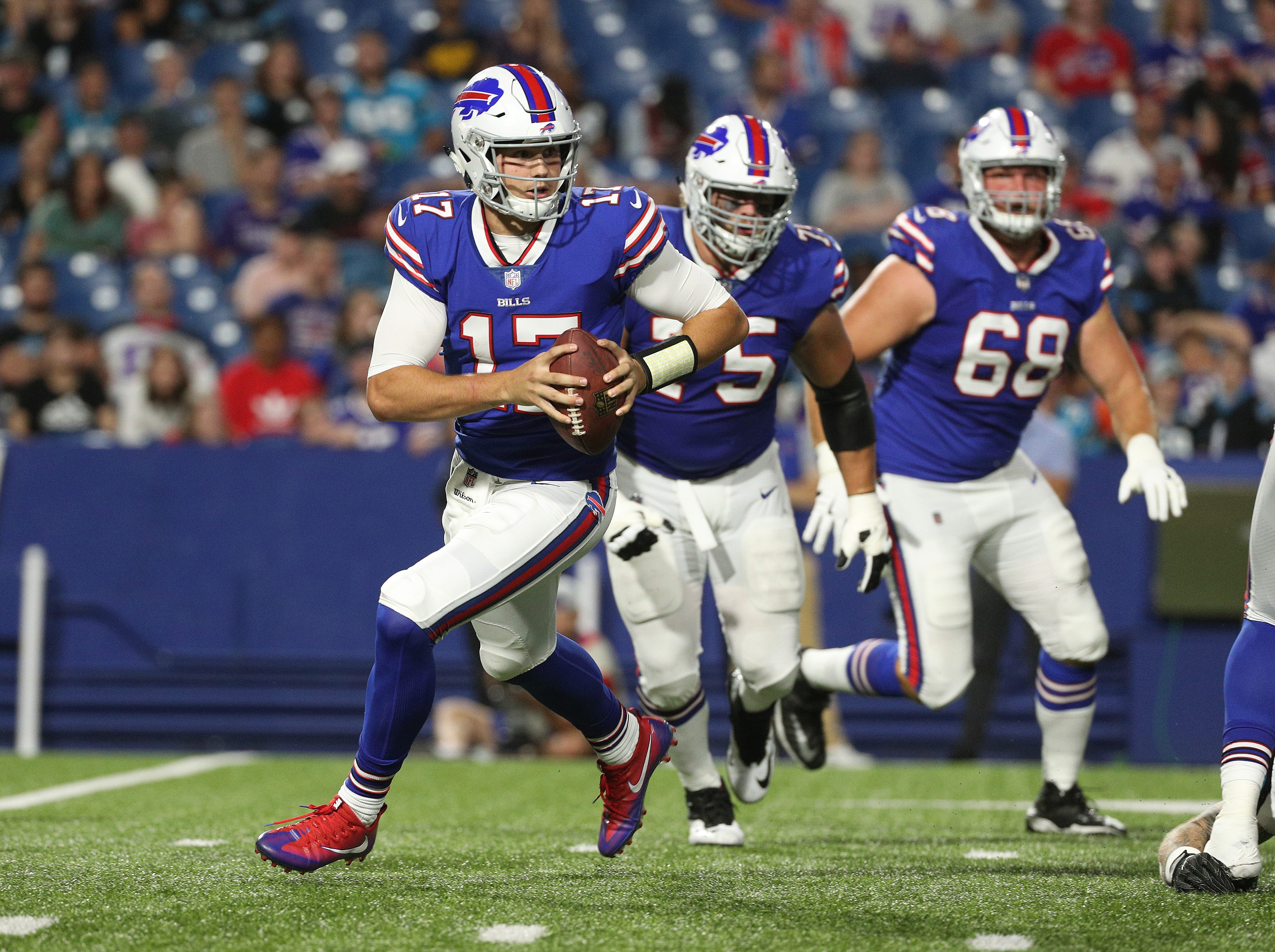Quarterback Josh Allen escapes pressure by rolling out of the pocket.