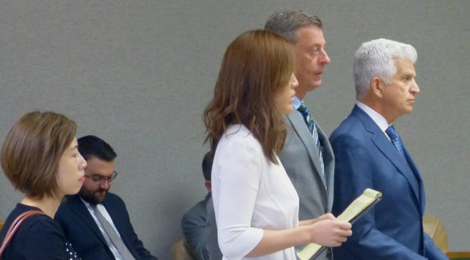 Kelsi Hoser, far left, is shown Friday in Shasta County Superior Court with defense attorney Naomi Chung, co-defendant Jonathan McConkey and defense attorney Jon Runfola.