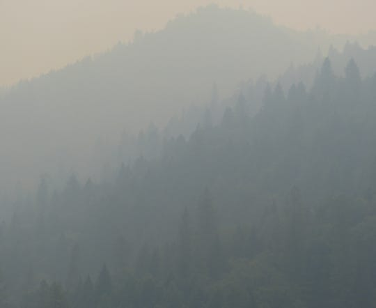 The hills and mountains north of Redding were barely visible Thursday, Aug. 9, 2018 due to thick smoke from the Carr Fire and other blazes.