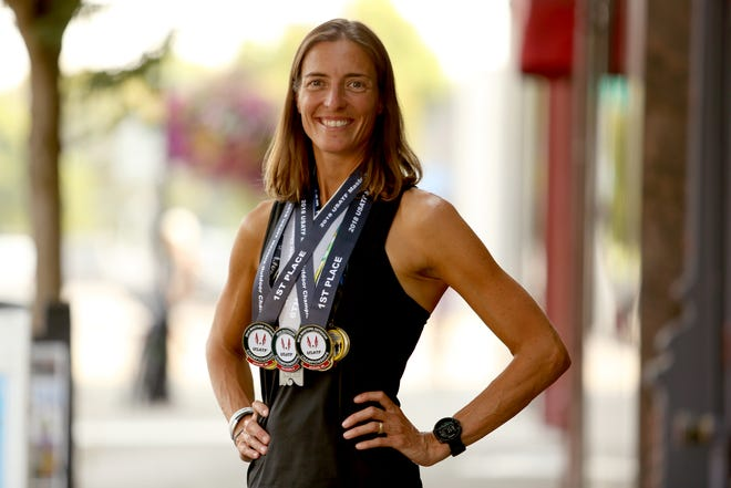 Lydia McGranahan, 41, of Keizer, started competitive race walking less than two years ago and is now placing first in national competitions, with her sights set on the 2020 Tokyo Olympics. Photographed in downtown Salem on Thursday, Aug. 9, 2018.