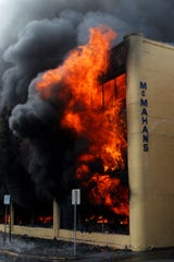 A four-alarm fire claims McMahan's at State and Commerical streets in Downtown Salem.