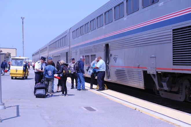 The southbound Amtrak Coast Starlight arrives after the ceremony for the kick start to the Monterey County Rail Extension.