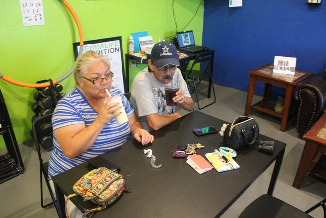Lolly and Arnold Montelongo enjoy a meal replacement shake and energy tea at Redefined Nutrition on Aug. 1, 2018.