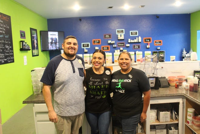 Redefined Nutrition owners Jessica and Albert Garcia pose with partner Geneva Rodriguez on Aug. 10, 2018.