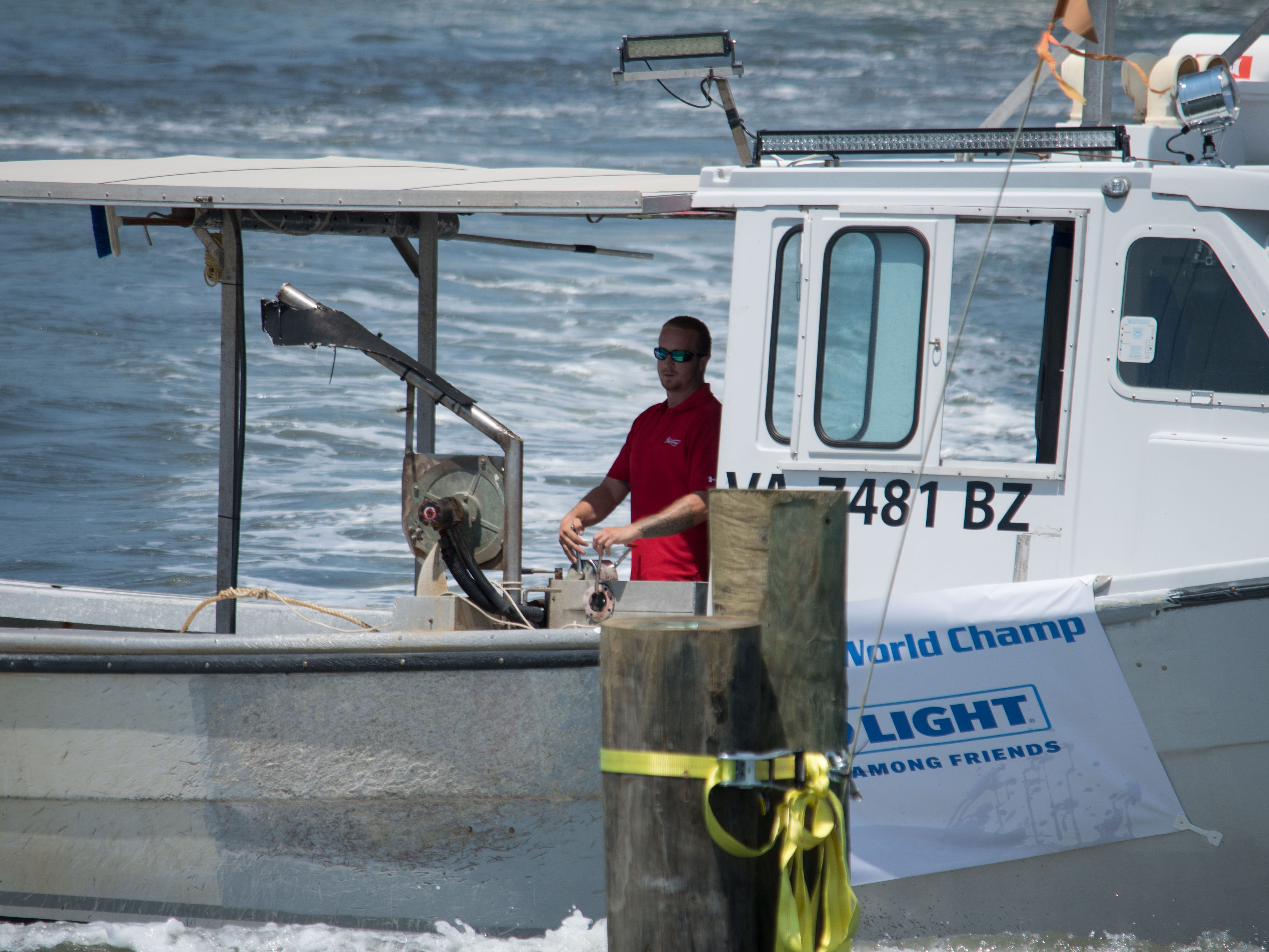 Thomas Heath positions the Kristy Lynn in order to dock on Sunday, Aug 5, in Cape Charles.
