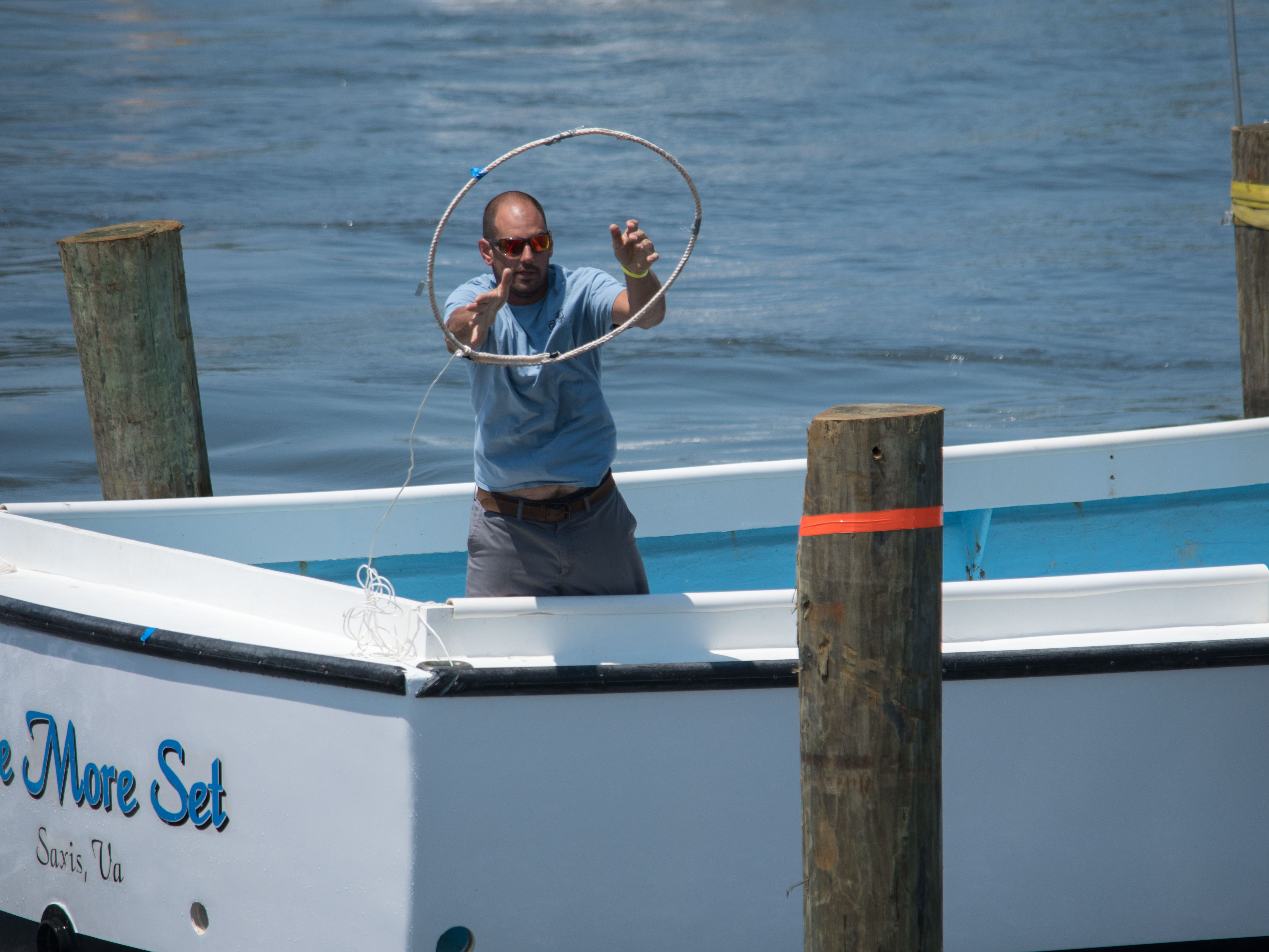 Donnie Porter, captain of the One More Set, tosses a piling hoop during the Boat Docking Contest on Sunday, Aug 5.