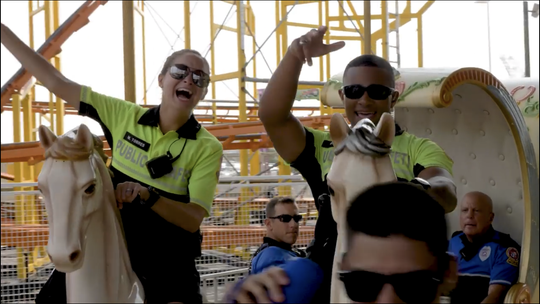Members of the Ocean City Police Department participate in the lip sync challenge video on a carousel.