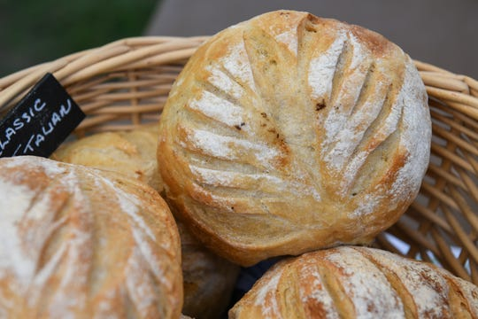 Loaves of freshly baked bread sit on display at Greg Zacziewicz's stall at the Princess Anne farmers market on August 9.