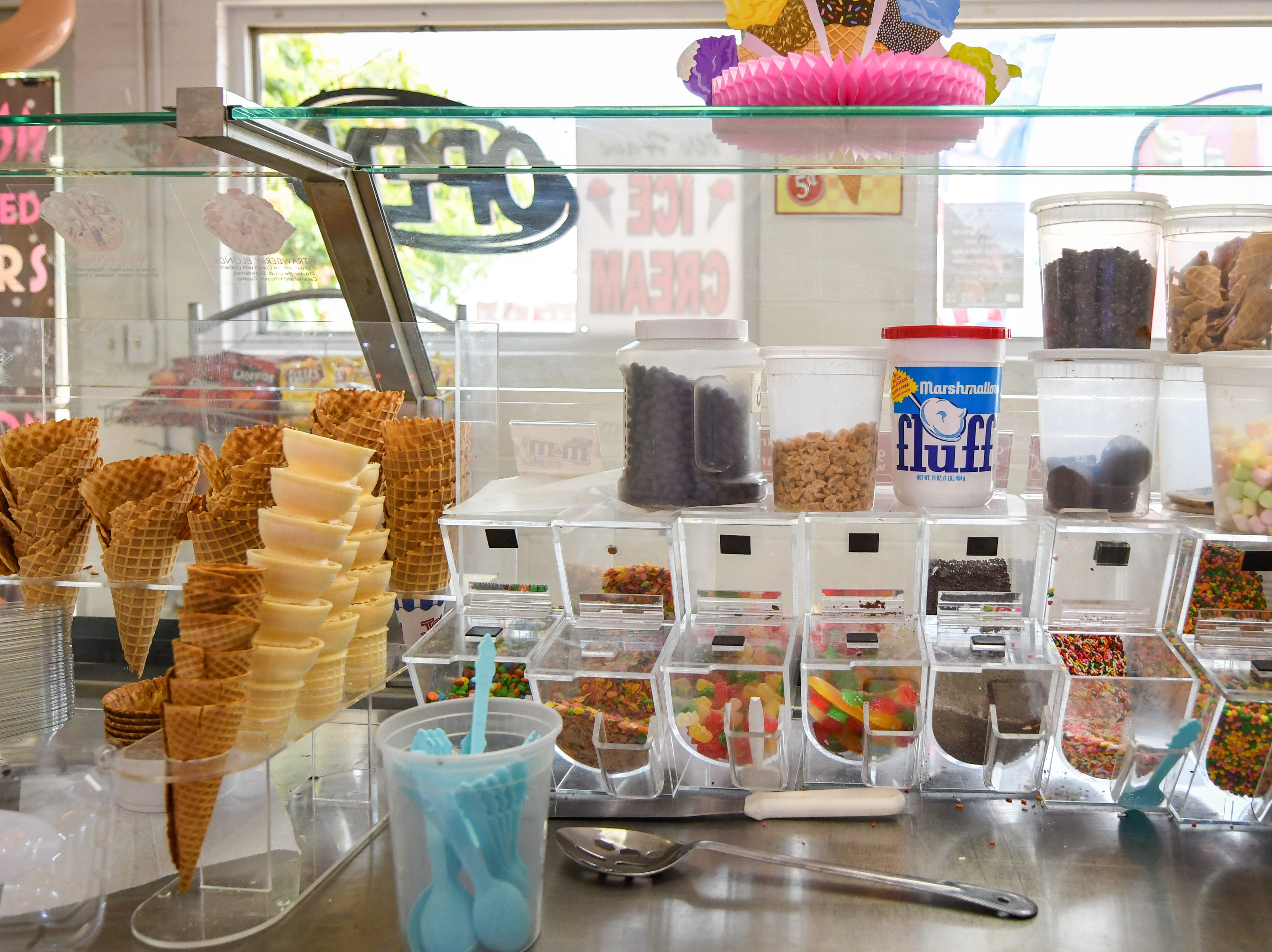 Customers can choose from a variety of toppings and cones at new bakery Johnnysweets in Crisfield.
