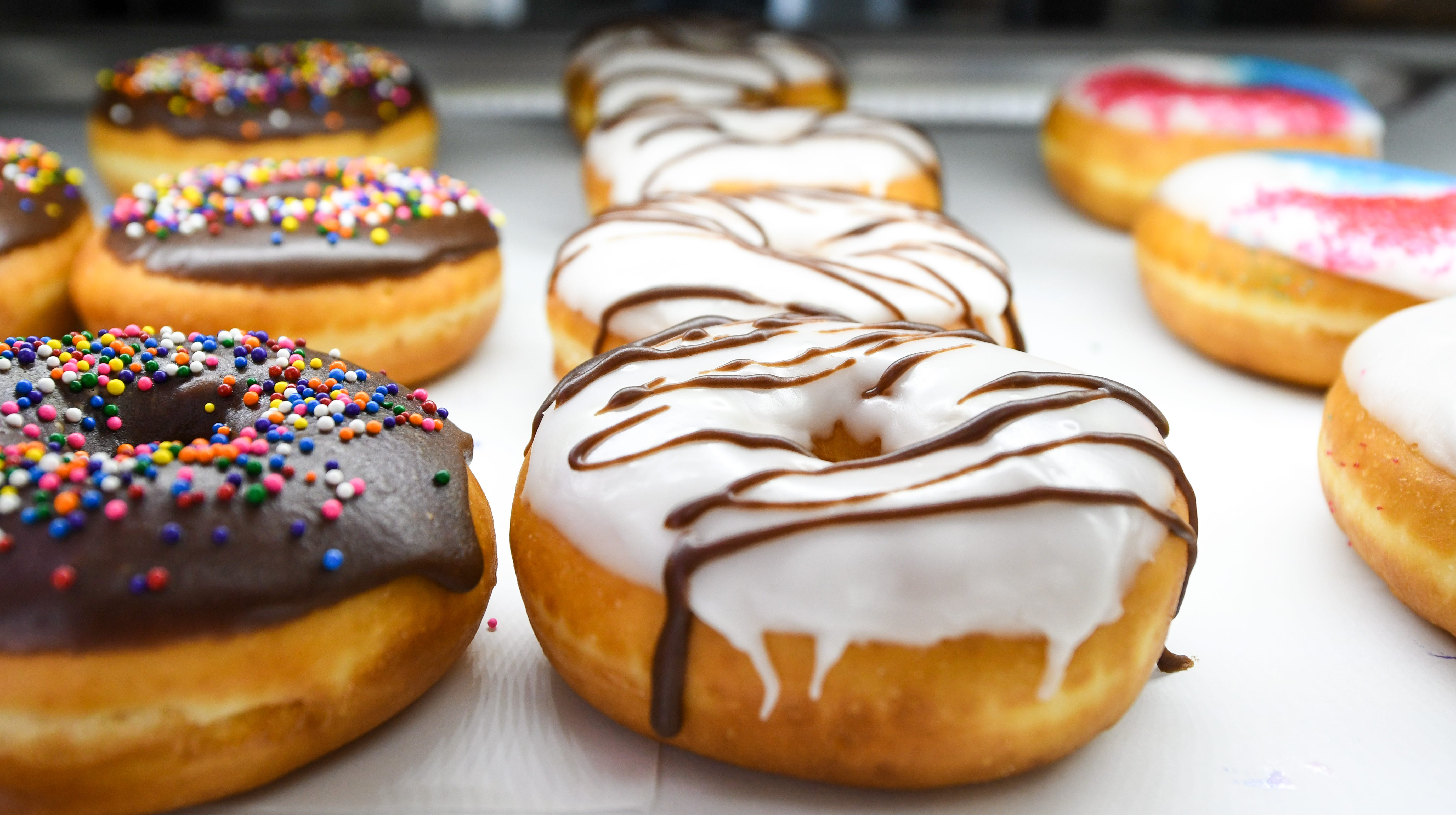 Homemade doughnuts sit in the display case at new bakery Johnnysweets in Crisfield on August 9.