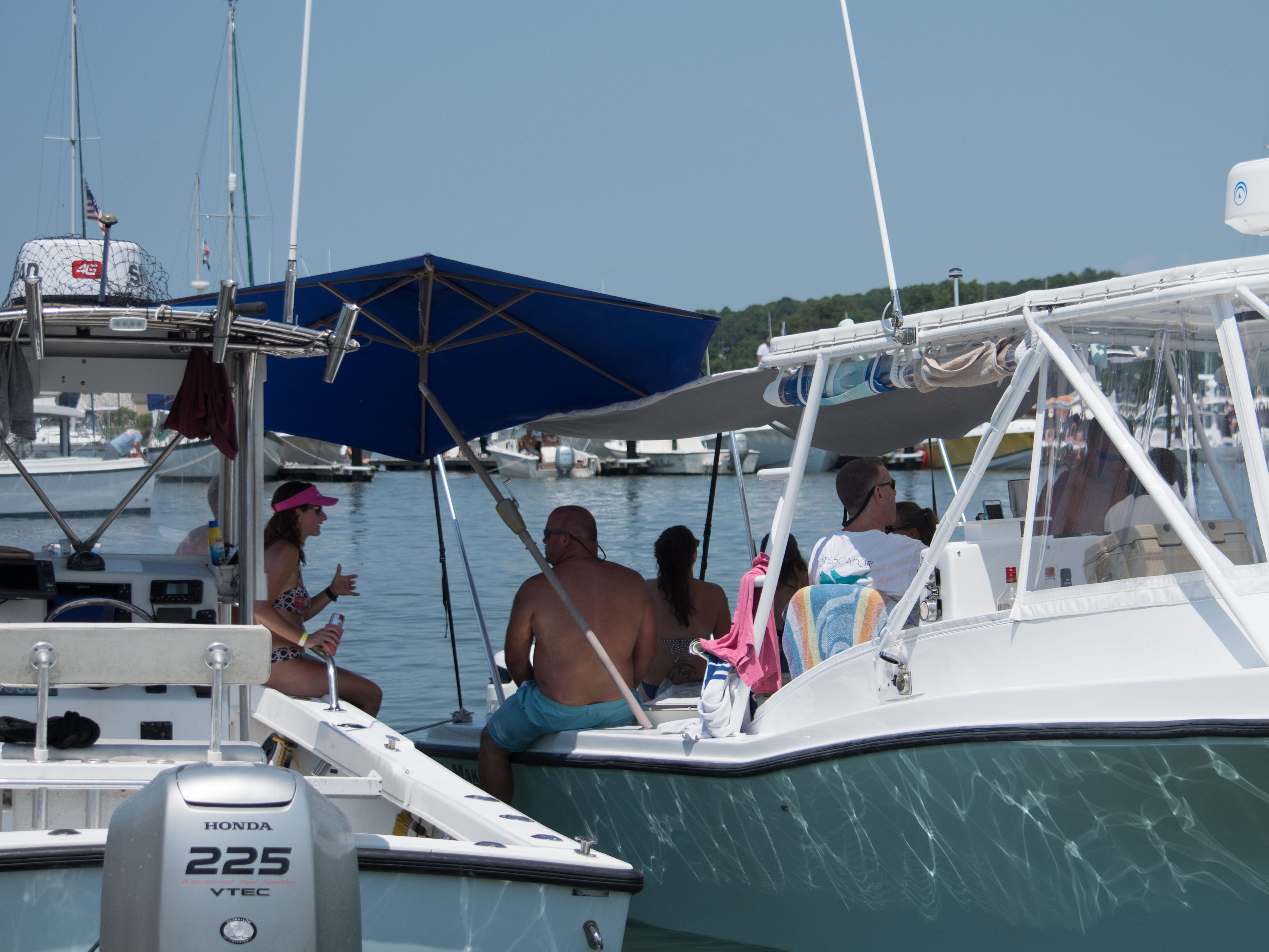 Spectators relax on the sidelines to watch the Boat Docking Contest on Sunday, Aug 5,  in Cape Charles.