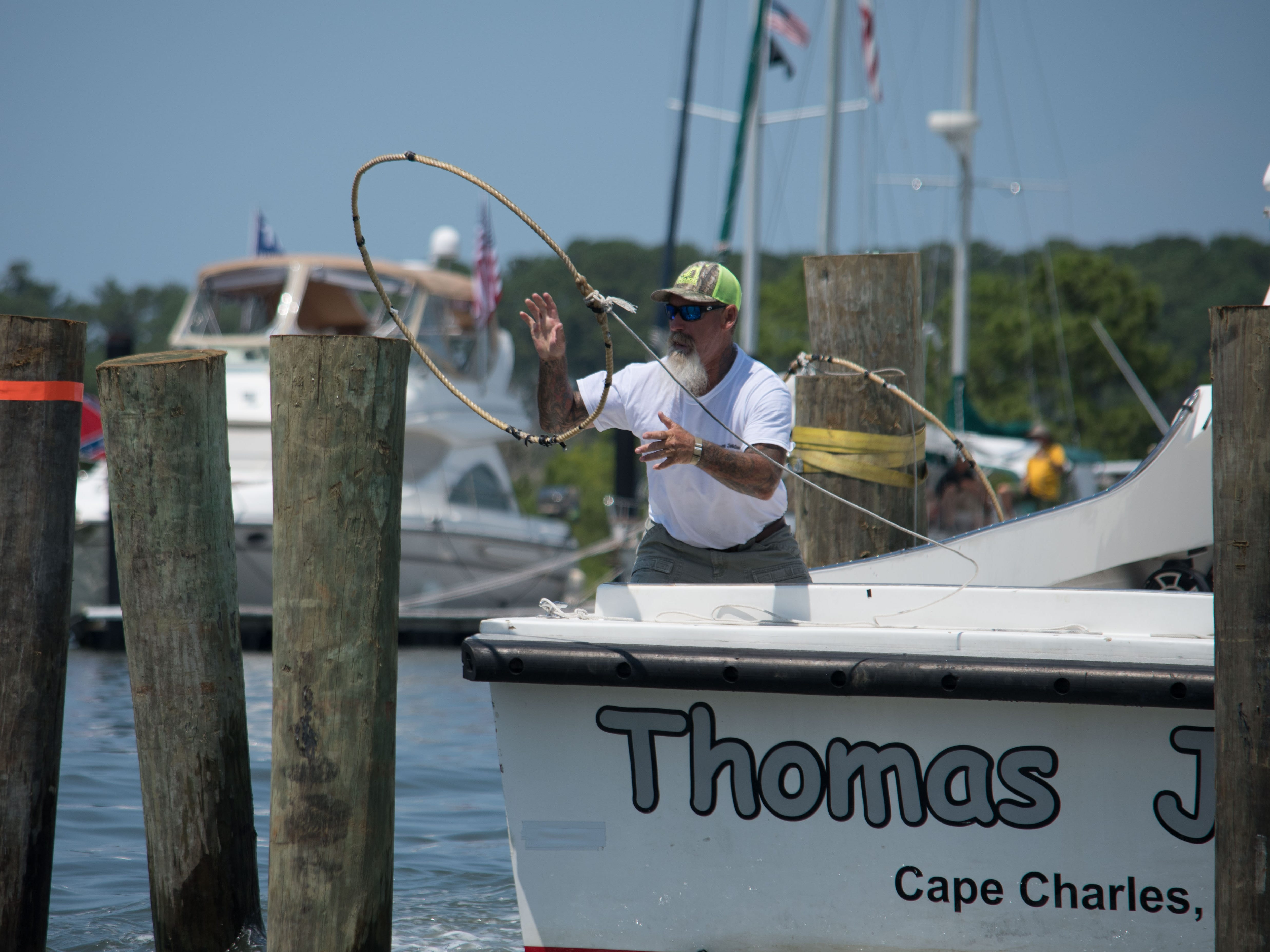Kenny Heath, champion of the 2018 Boat Docking Contest, finishes docking the Thomas Jaiden with a time of 29 seconds in Cape Charles.