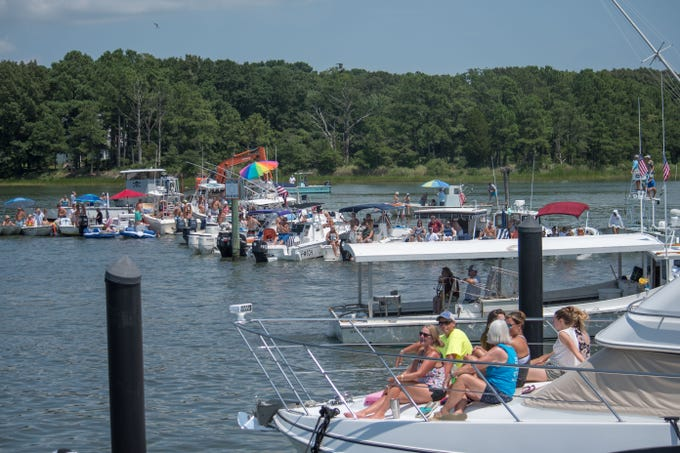 Boats surround the Cape Charles Marina to watch the afternoon's boat docking competition on Aug. 5.