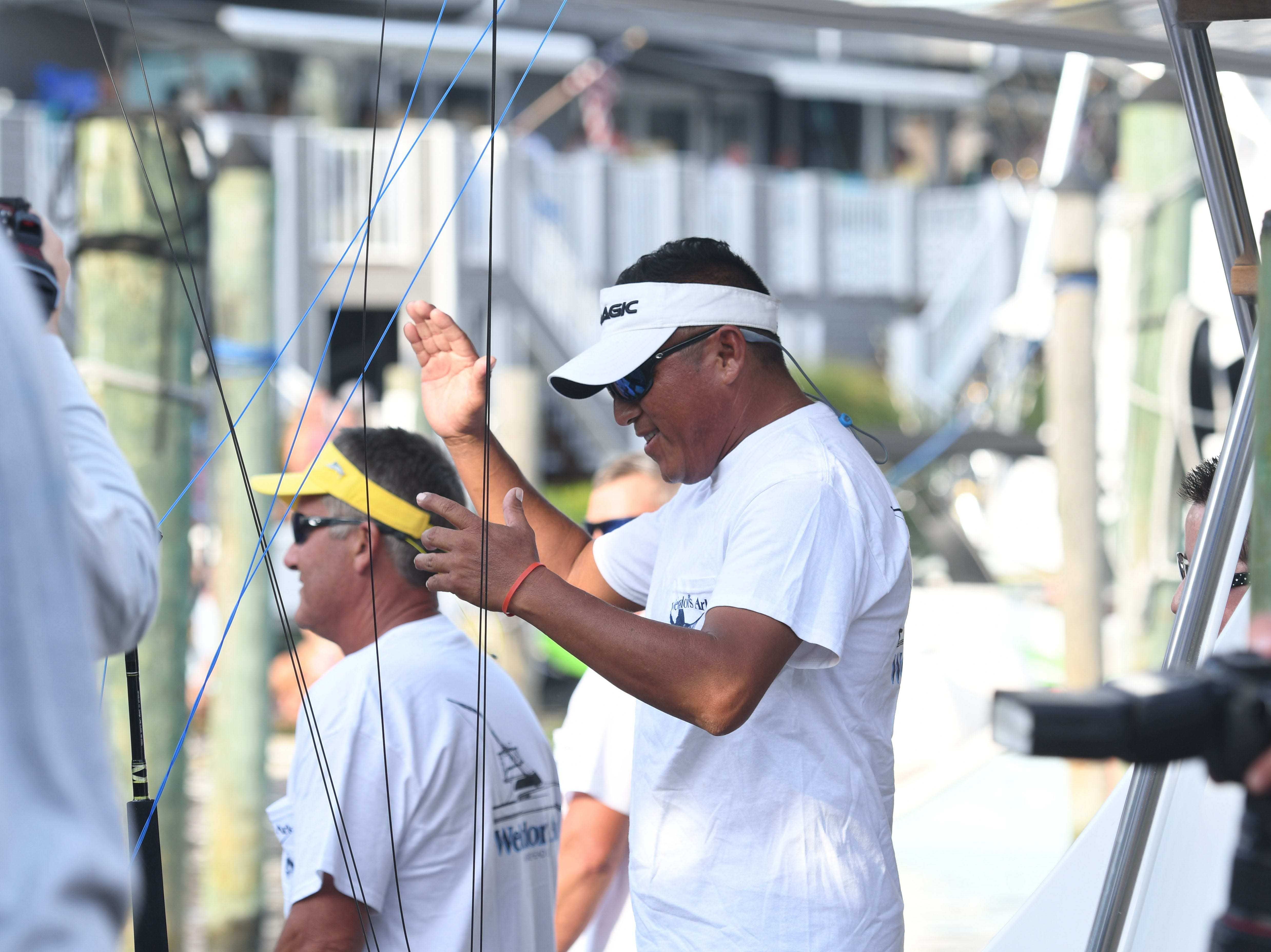 Angler Pascual Jimenez cheers aboard the Weldor's Ark after learning he is now tied for first place with an 83 pound white marlin during the 45th Annual White Marlin Open in Ocean City, Md. on Friday, August 10, 2018.