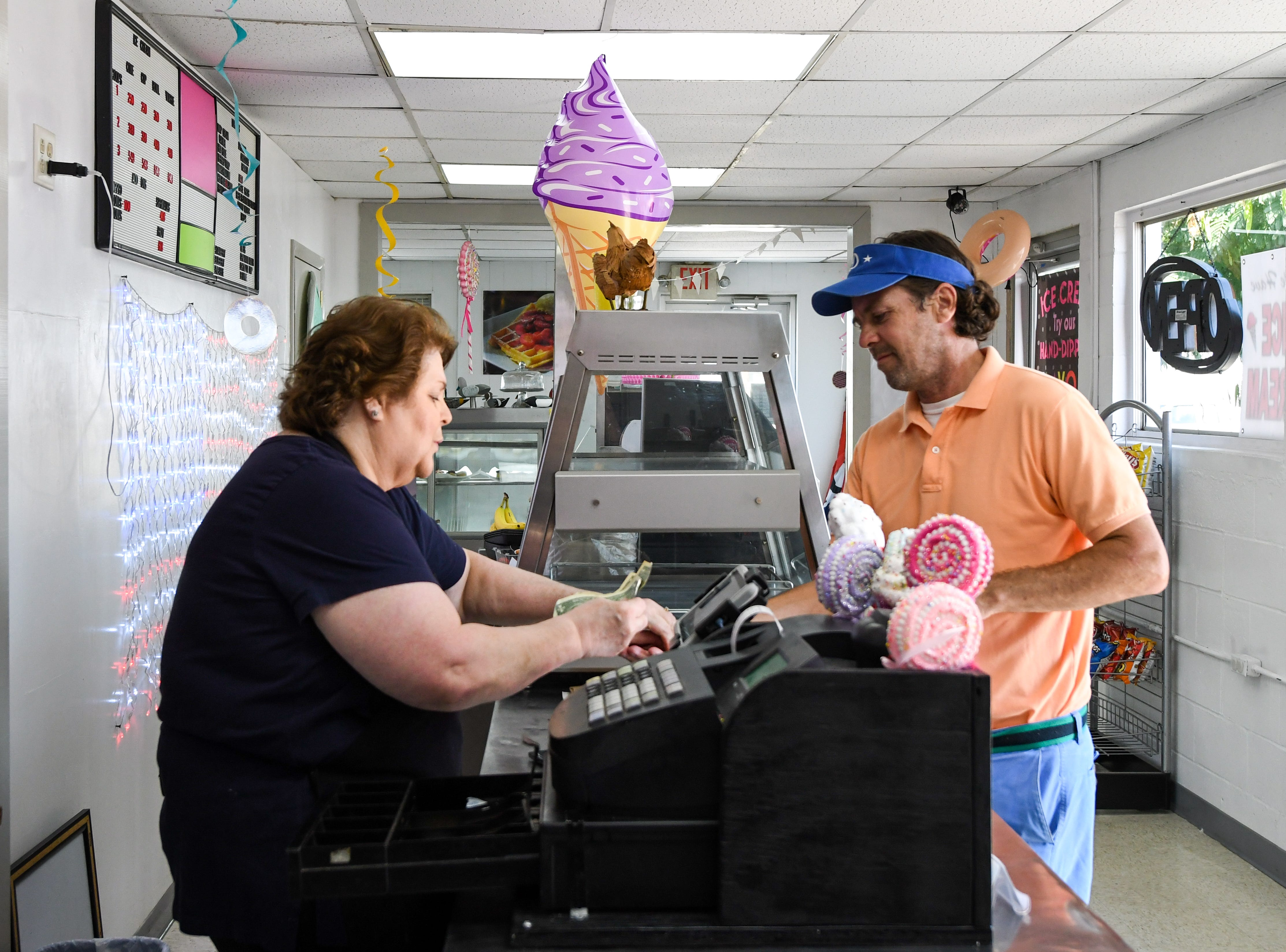 Kathy Konkel serves a customer at new bakery Johnnysweets in Crisfield on August 9.