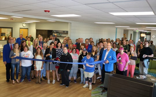 A recent ribbon cutting celebrated RCS Empowers' new lobby and entryway. RCS Empowers Executive Director Martha VandeLeest cut the ribbon joined by RCS workers, staff, board members and Chamber Executive Director Deidre Martinez.
