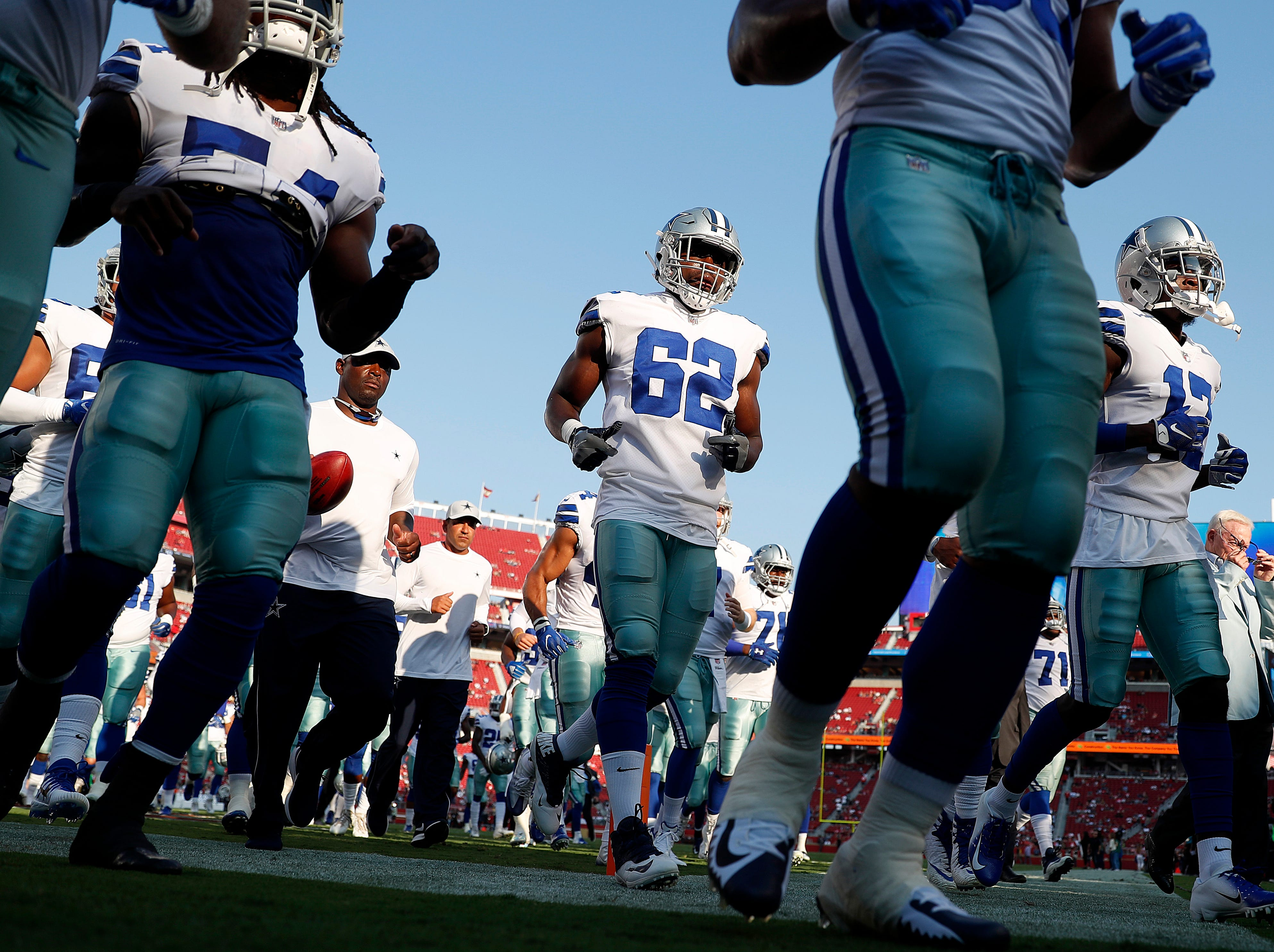 Dallas Cowboys players run off the field before an NFL preseason football game between the San Francisco 49ers and the Cowboys in Santa Clara, Calif., Thursday, Aug. 9, 2018. (AP Photo/Tony Avelar)