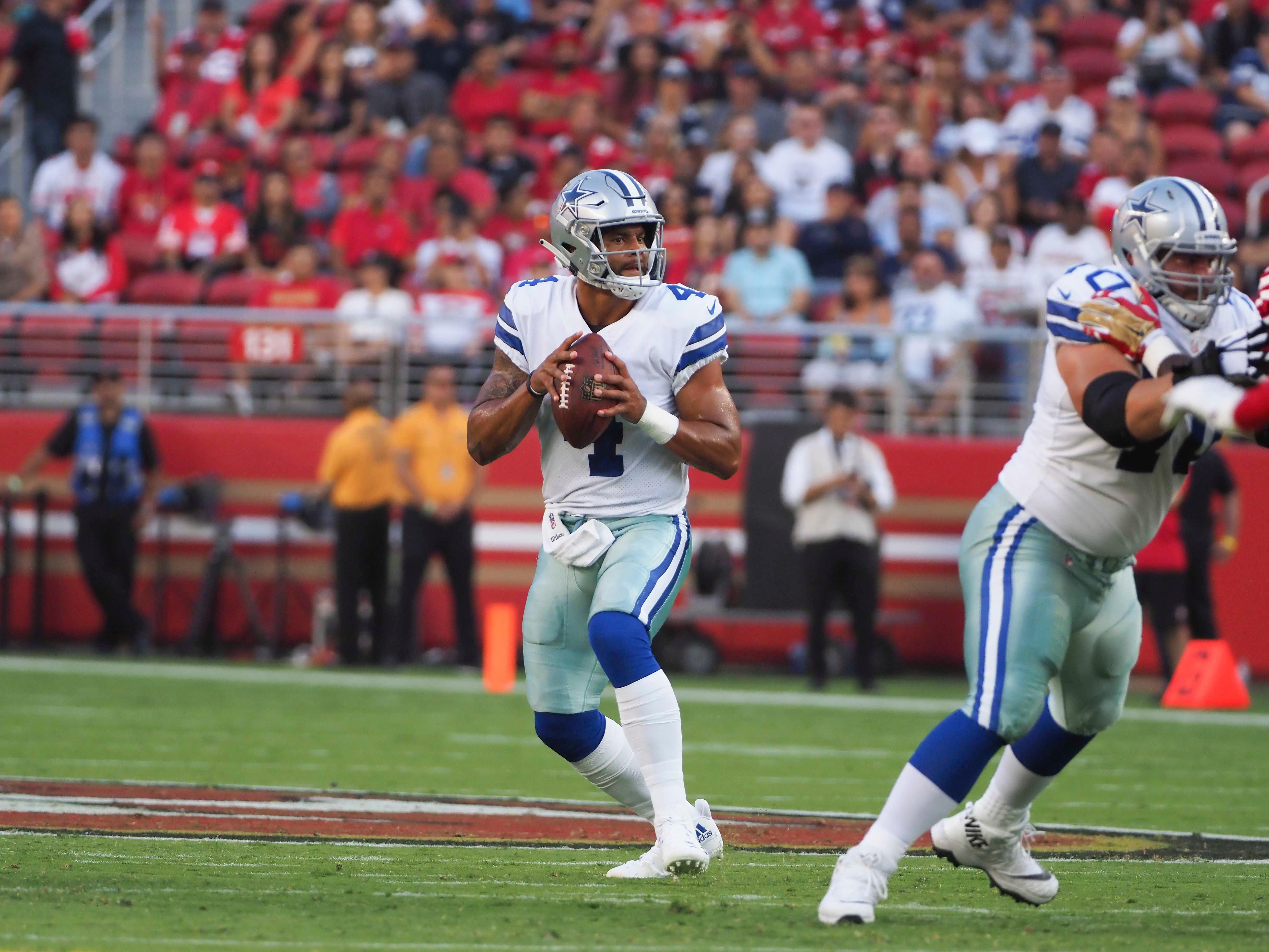 Aug 9, 2018; Santa Clara, CA, USA; Dallas Cowboys quarterback Dak Prescott (4) controls the ball against the San Francisco 49ers during the first quarter at Levi's Stadium. Mandatory Credit: Kelley L Cox-USA TODAY Sports