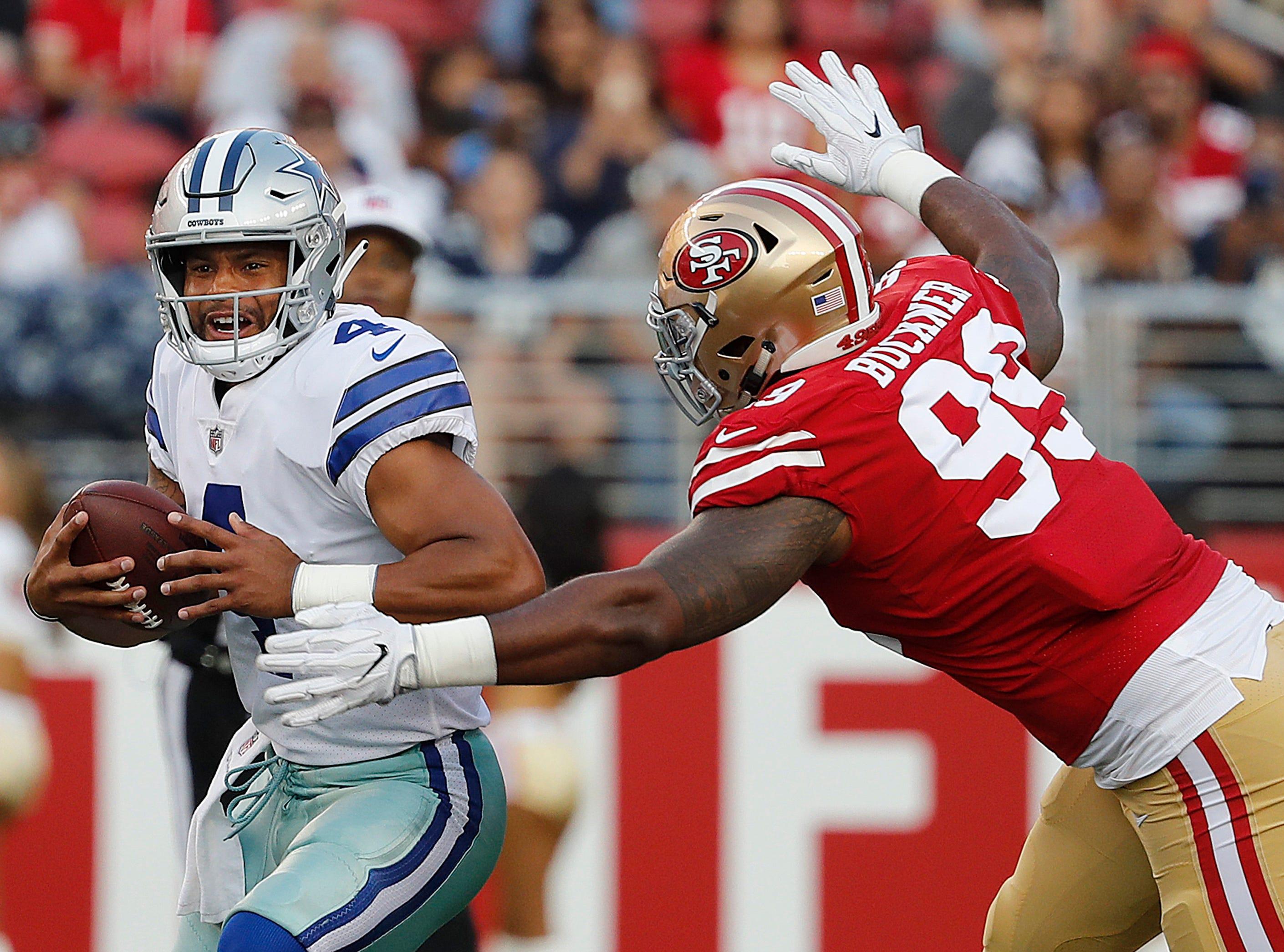 San Francisco 49ers defensive end DeForest Buckner (99) closes in to sack Dallas Cowboys quarterback Dak Prescott (4) during the first half of an NFL preseason football game in Santa Clara, Calif., Thursday, Aug. 9, 2018. (AP Photo/Josie Lepe)