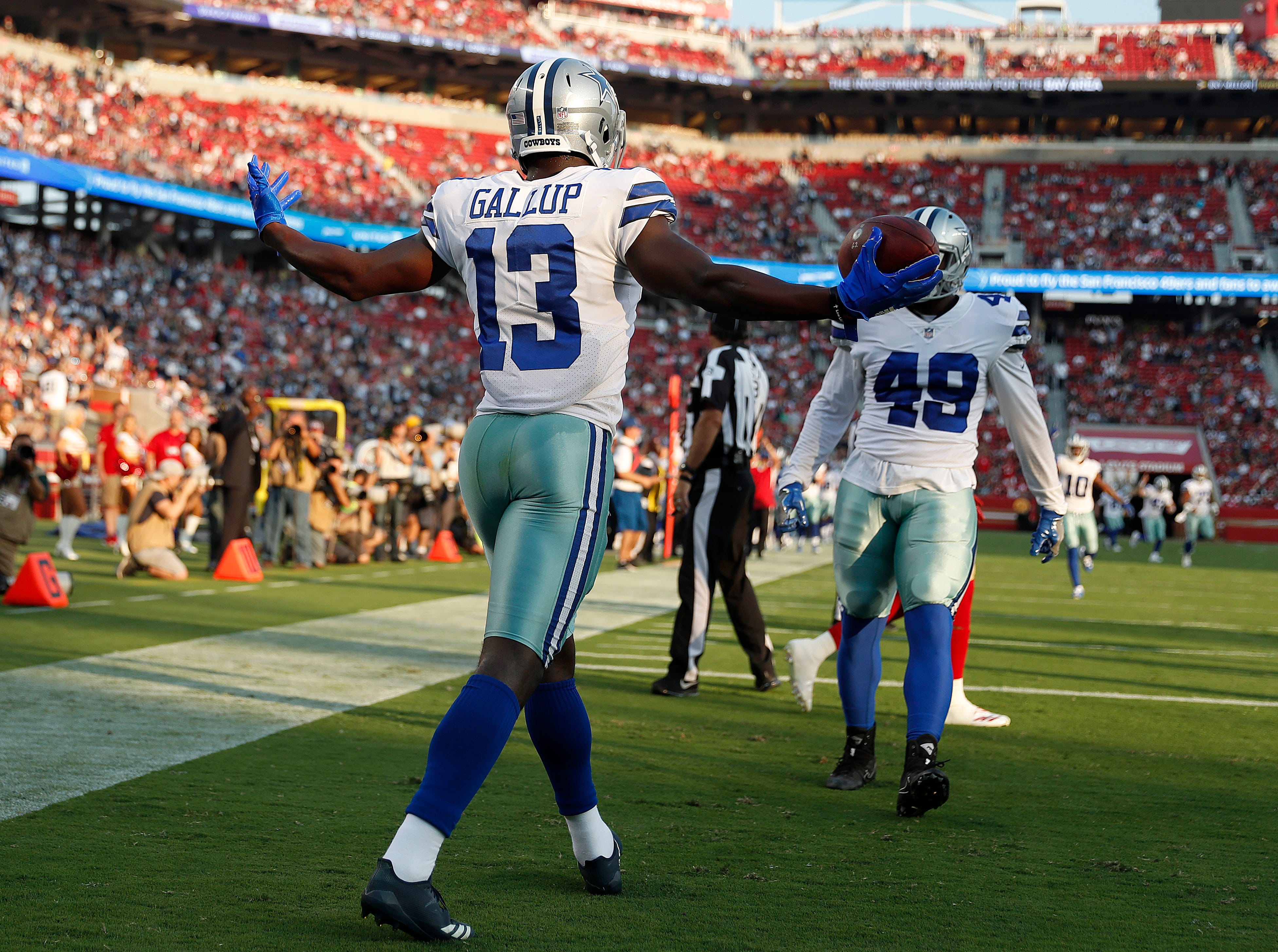 Dallas Cowboys wide receiver Michael Gallup (13) celebrates after scoring a touchdown against the San Francisco 49ers during the first half of an NFL preseason football game in Santa Clara, Calif., Thursday, Aug. 9, 2018. (AP Photo/Tony Avelar)