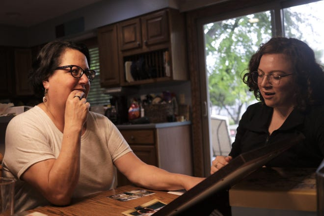 Amber's mother Karla Abbott and sister Frances Thompson look at photos of Amber in their west side Sioux Falls home July 30, 2018.
