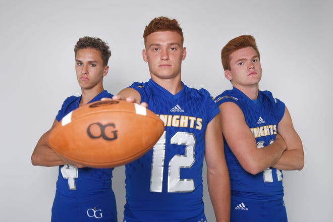 O'Gorman High School's Andrew Pujado, from left, Canyon Bauer and Noah Reeves during football media day Tuesday, Aug 7, at Argus Leader Media in Sioux Falls.