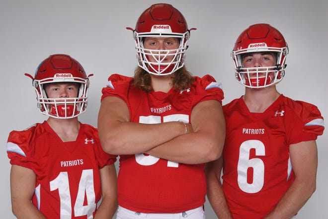 Lincoln High School's Avry Rice, from left, Grant Treiber and Zach Hanson during football media day Tuesday, Aug 7, at Argus Leader Media in Sioux Falls.