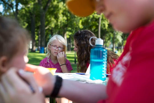 Olivia Warne paints Ariah Wiebe's face at McKennan Park in Sioux Falls, S.D. Tuesday, July 31, 2018.