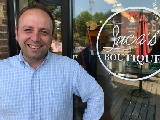Luca Papini, owner of Luca's Boutique, poses for a portrait in front of his store at 8th and Railroad Center. The East Bank area in downtown is in transition after Josiah's and Prairie Berry left and owners Erika and David Billion plan for a massive development to the east.