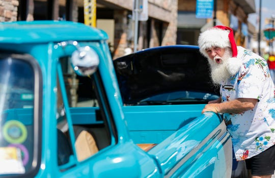 Kerry Walton from Melbourne, Australia makes a face of excitement as he checks out a classic Chevy truck during the Birthplace of Route 66 Festival on Friday, Aug. 10, 2018. Walton is attending the festival for his second year in a row.