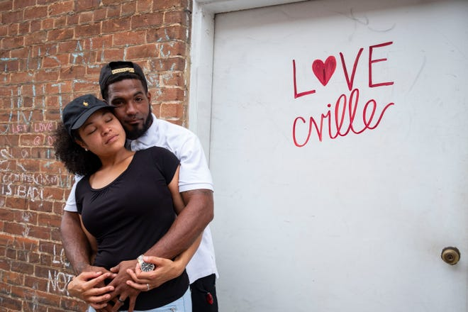 Newlyweds Marcus and Marissa Martin on the Charlottesville, Va., street where their friend, Heather Heyer, was killed in last year's deadly car attack.